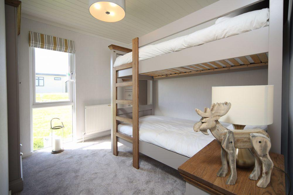 3 Bedroom Wooden Lodge for Sale in Plas Coch Holiday Home Park, LL61 6EJ